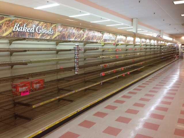 Empty shelves inside a Tewksbury Market Basket on August 5, 2014.