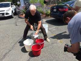 Pictured here is Randy Price getting the buckets of ice ready.