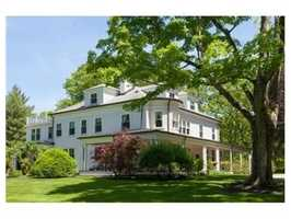 Thehome sits atop a ridge on 5.79 acres approached by a winding, tree-lined driveway.