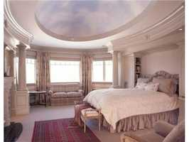 Master suite with sweeping views of manicured grounds.