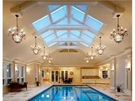 Home office looks out over 61x39 indoor swimming pool.