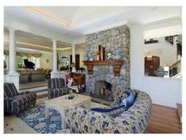 Great room, and intimate sitting area with floor to ceiling stone chimney.