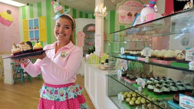 "Taylor Stump displays her cupcake masterpieces at the Little Miss Cupcape bakery on Main Street Hyannis, Mass. Stump, dubbed ""the cupcake queen"" in high school, graduated from college in May and opened her business the next month."