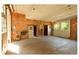 An equestrian property w/3 stall barn, dressage ring, 3 paddocks & carriage hse with apt.