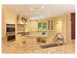 The kitchen has beautifully executed high-end cabinetry & appliances.