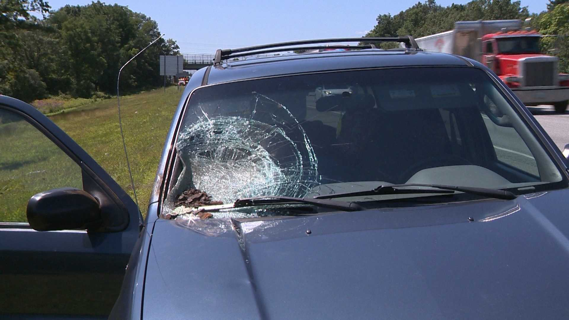 Route 495 car smashed by debris 8.19