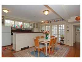 There's alarge family kitchen with a raised hearth fireplace.