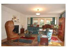 Just off Brattle Street, a grand foyer and staircase draw you into the house.
