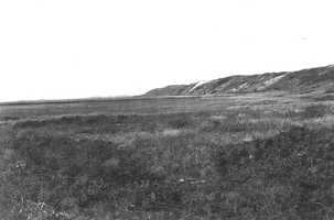 Cape Cod National Seashore, Massachusetts. Old sea cliff on the west side of Pilgrim Heights, looking north 22 degrees west from the railroad track in the marsh. June 5, 1916.