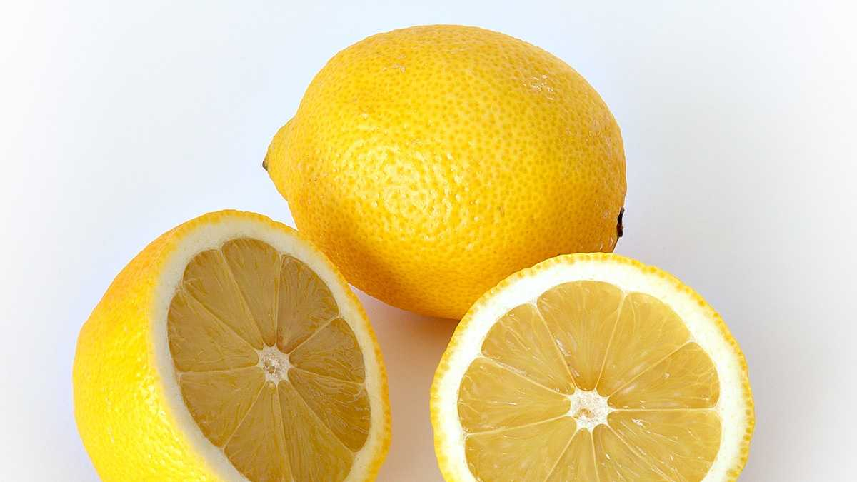 Cover a cotton ball in lemon juice and leave it in your fridge. After a few hours, the smell will be gone.