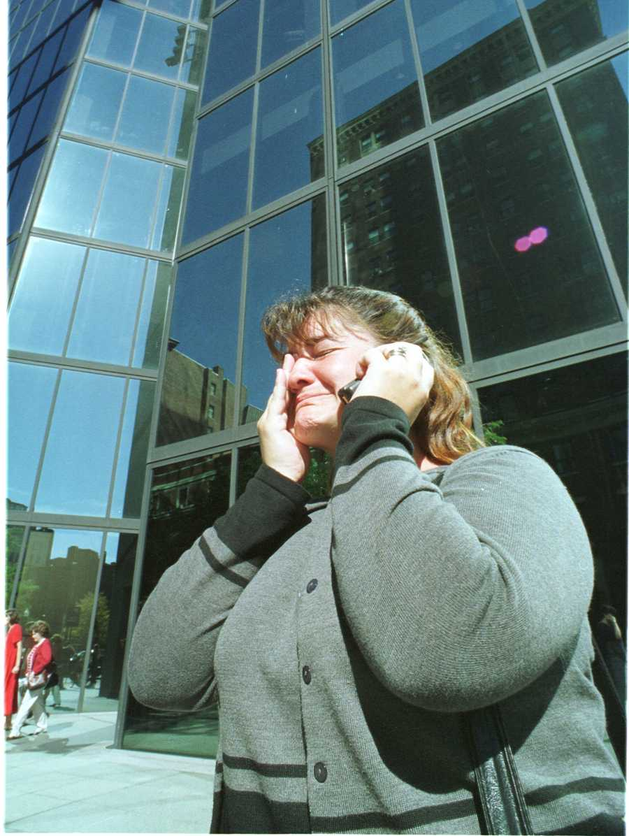Tracy Yoffe of Uxbridge, Mass., wipes away tears as she makes a call on a cellphone Tuesday, Sept. 11, 2001, in Boston, after she evacuated her law office in the John Hancock Builiding in Boston. Highrise office buildings in downtown Boston were evacauted as a safety precaution following the crashes of two aircraft into the World Trade Center buildings in New York.
