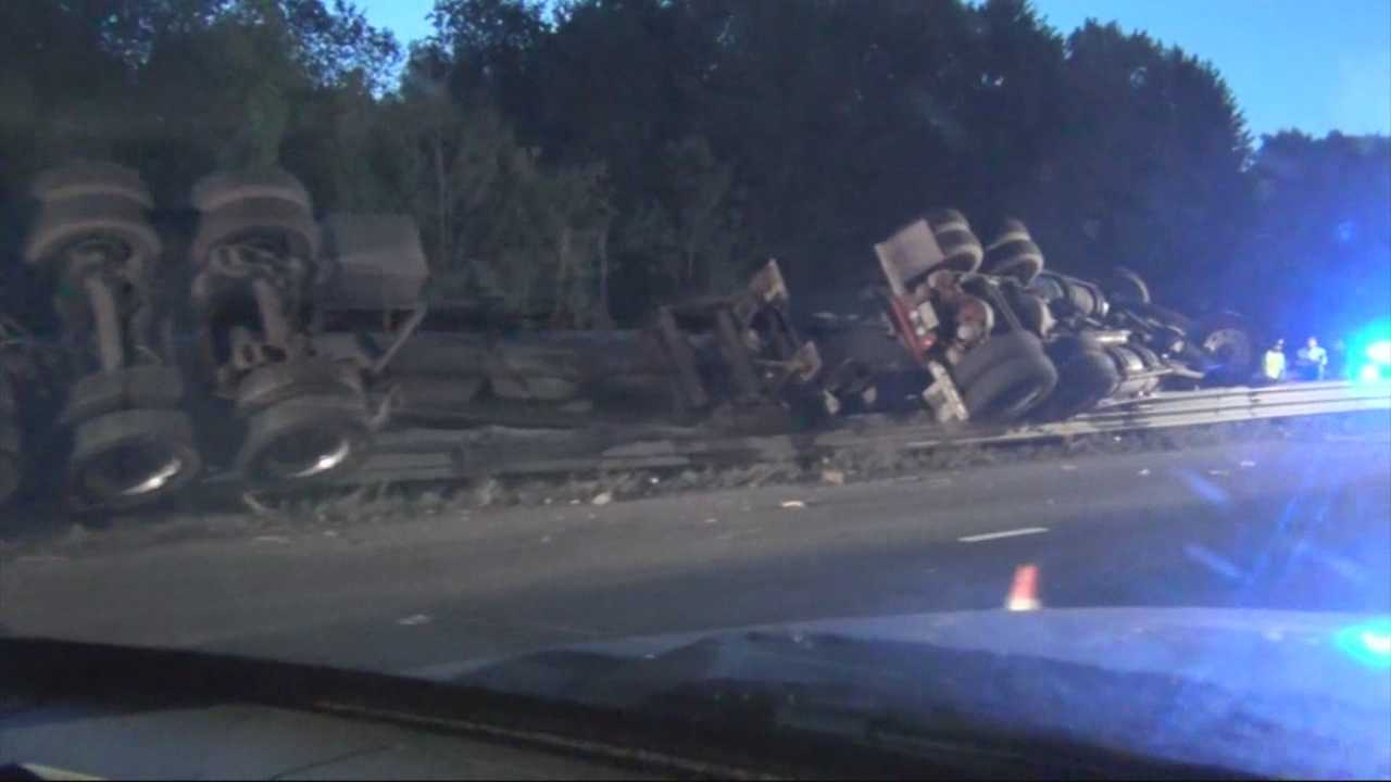 A driver was killed Saturday morning when his tractor trailer flipped on Route 128 in Lexington