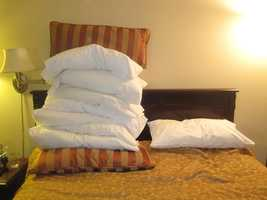 Keep decorative pillows and throw blankets to a minimum.