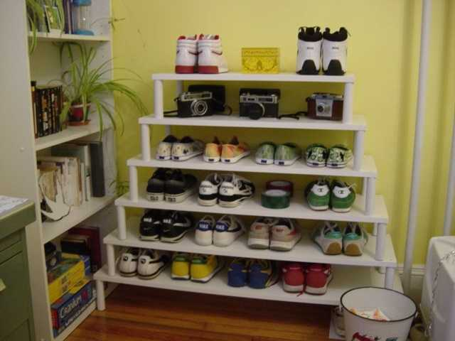 A shoe rack near the door can be a neat solution.