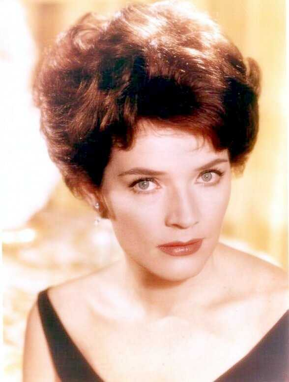 "Emmy-winning actress and singer Polly Bergen played the terrorized wife in the original ""Cape Fear"" and the first woman president in ""Kisses for My President,"" in a long career. A brunette beauty with a warm, sultry singing voice, Bergen was a household name from her 20s onward. In recent years, she played Felicity Huffman's mother on ""Desperate Housewives"" and the past mistress of Tony Soprano's late father on ""The Sopranos."" (July 14, 1930 – September 20, 2014)"