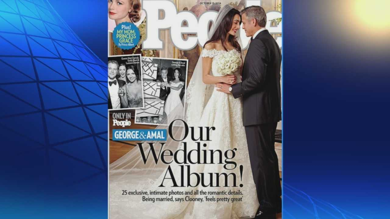 People Magazine has the first look at Amal Alamuddin's Oscar de la Renta wedding dress after her Venice marriage to George Clooney.
