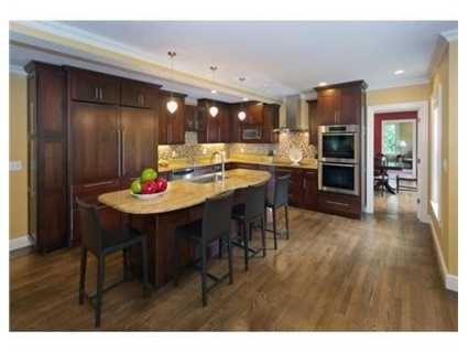 The kitchen is equipped w/ all the bells and whistles, double ovens, double dishwashers and a large eating island.
