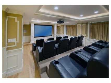 The lower level has a state of the art screening room w/ stadium seating, oversized game room and music room.