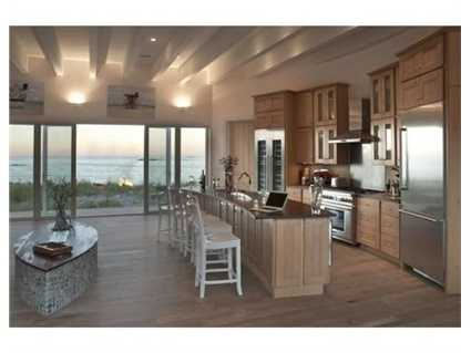 This one of kind home is not just near the beach... It is ON THE BEACH!