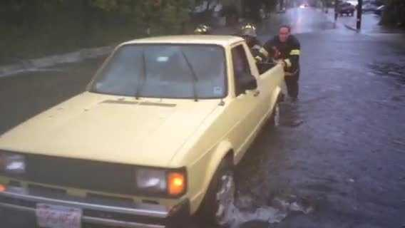 Firefighters help a stuck driver.