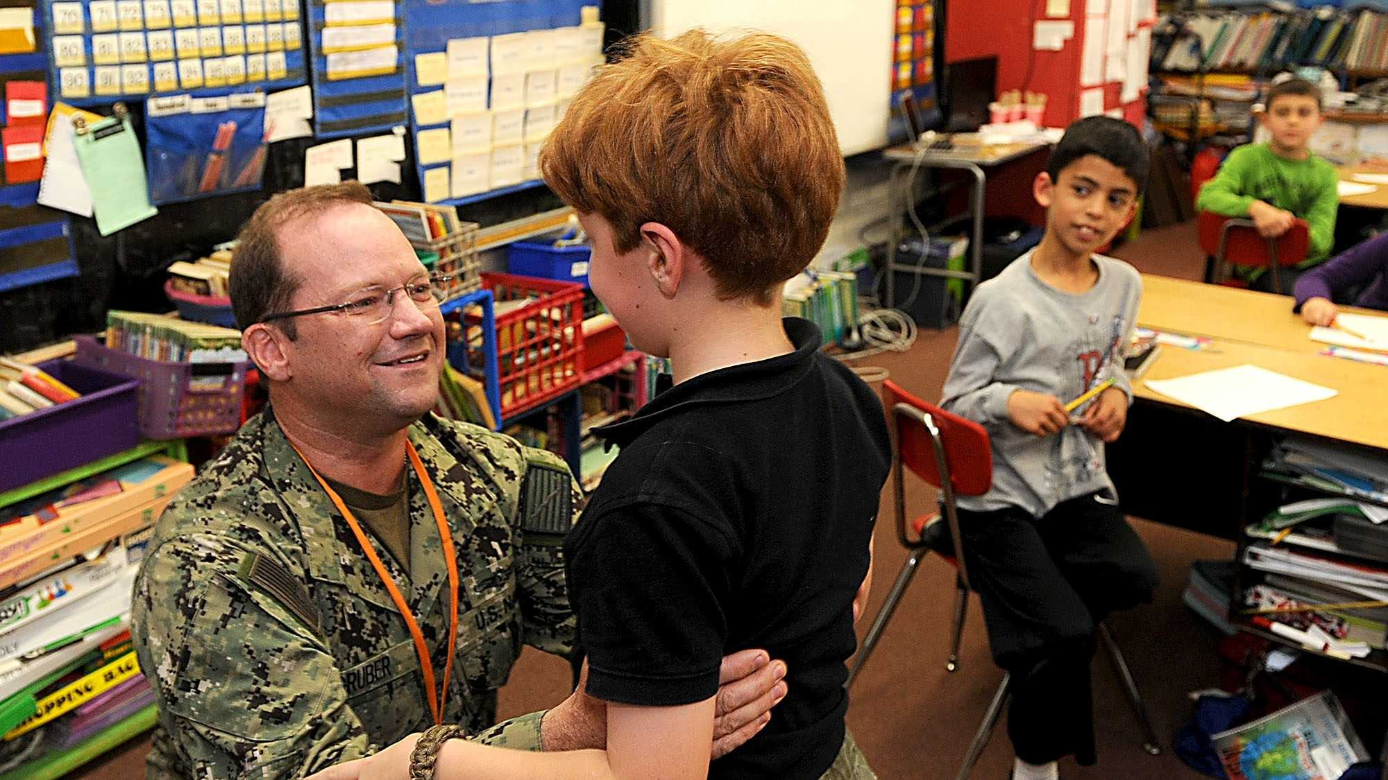 Navy Lt. Craig Gruber and his son had a surprise reunion in Florence Aldrich-Bennett's third-grade class shortly before dismissal Friday afternoon.