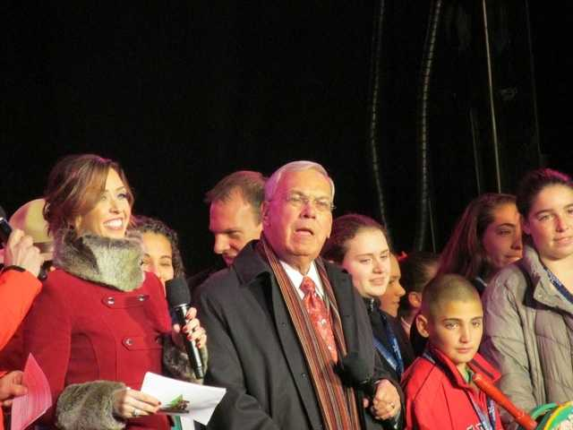"""Menino and NewsCenter 5's JC Monahan at the """"Holiday Lights"""" broadcast on the Boston Common in December 2013."""