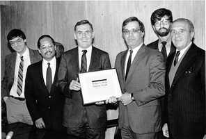 Councilor Brian McLaughlin, Councilor Charles Yancey, Mayor Raymond L. Flynn, Councilor Thomas M. Menino, Councilor David Scondras, Councilor Christopher A. Iannella in the mid 1980s.