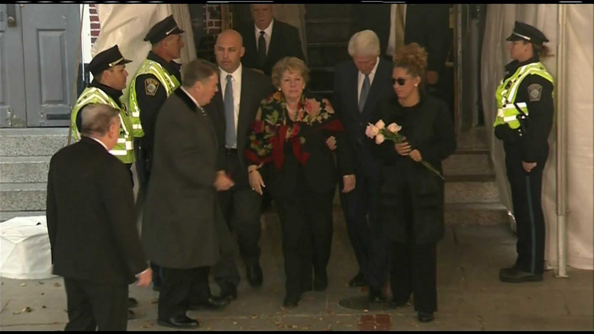 President Clinton escorts the Menino family out of Faneuil Hall.