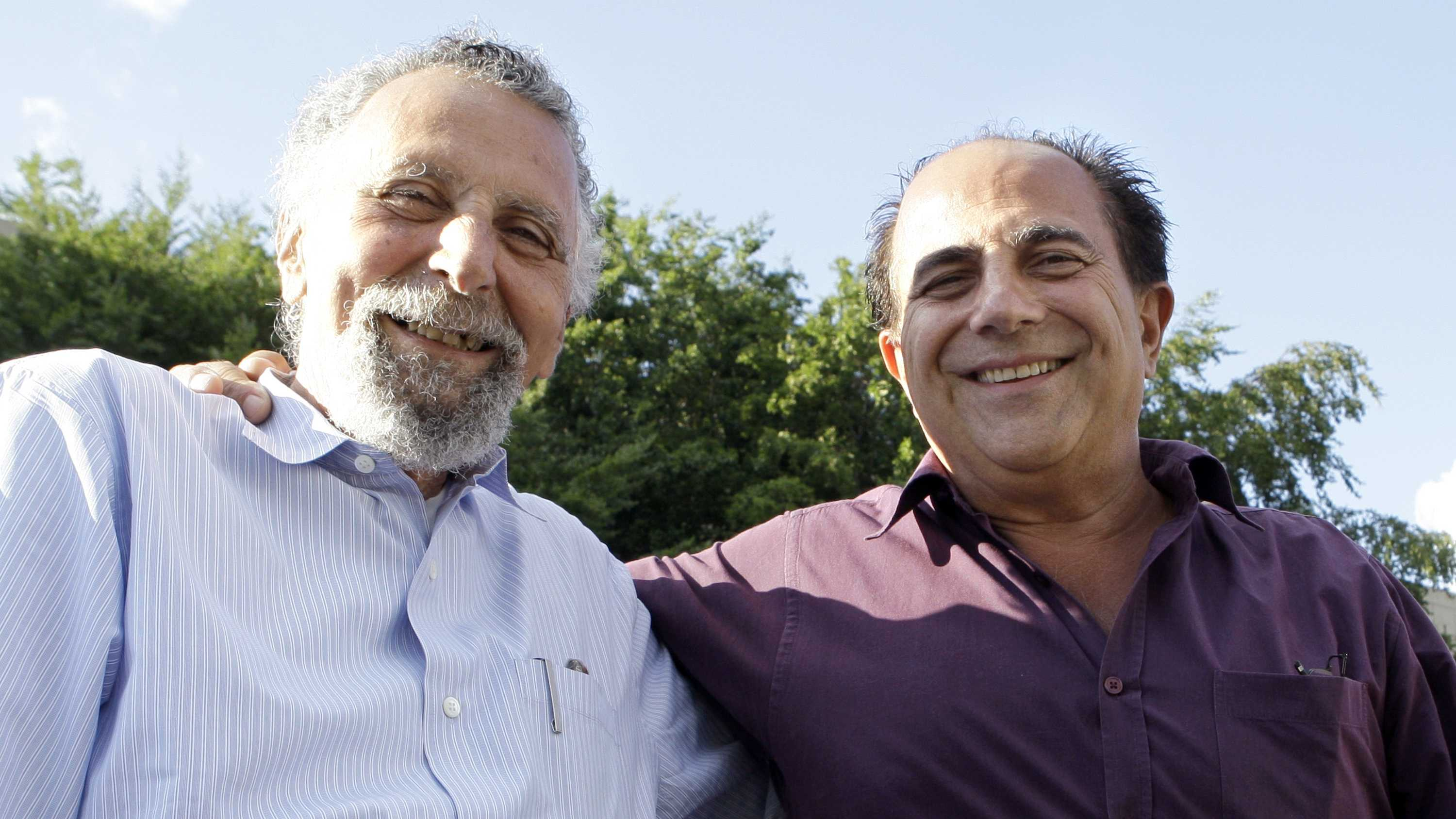 "Brothers Tom Magliozzi, left, and Ray Magliozzi, hosts of National Public Radio's ""Car Talk"" show, pose together in Cambridge, Mass., on Thursday, June 19, 2008."