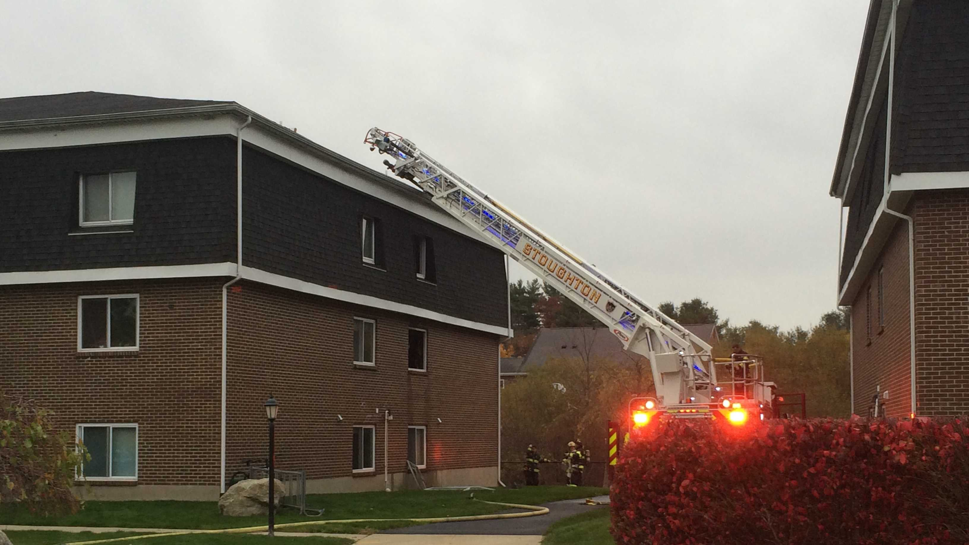 Firefighters battled a three-alarm fire at a Stoughton apartment building.