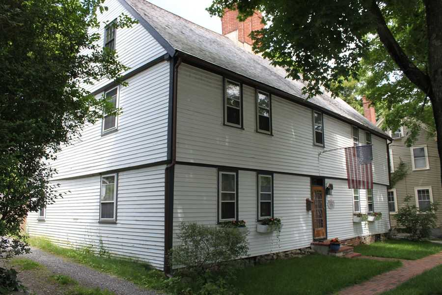 The Captain Matthew Perkins House at 8 East St. in Ipswich. The 1st period 2 story house has end gables, a timber frame, clapboard siding, an elaborate pilastered chimney, a rear ell, and early English style overhangs front and side. The house dates to about 1710 and was formerly known as the Morton-Corbett House.Read more at Historic Ipswich. All photos courtesy Gordon Harris, Town Historian.  Read his blog on Ipswich historic homes.