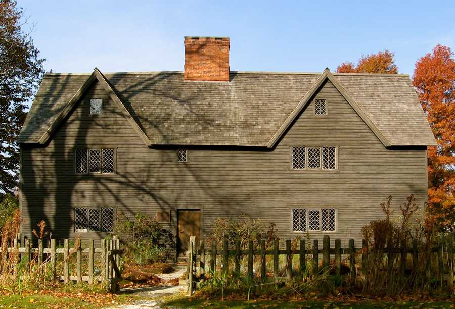 """The 1677 Whipple house at 1 South Village Green is a National Historic Landmark owned by the Ipswich museum, and is one of the finest examples of """"first period"""" American architecture (1625-1725). The Whipple House has the original frame, large fireplaces, summer beams, wide board floors, and gun-stock posts. Originally at the corner of Market Street and Saltonstall Street, the Ipswich Historical Society saved the house from destruction, restored it, and then moved it over the Choate Bridge to its present location in 1927.Read more at Historic Ipswich. All photos courtesy Gordon Harris, Town Historian.  Read his blog on Ipswich historic homes."""