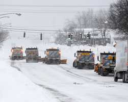 State snowplows clear Union Road on Thursday, Nov. 20, 2014, in West Seneca, N.Y.