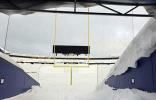 Snow covers the interior and field at Ralph Wilson Stadium in Orchard Park, N.Y. Friday, Nov. 21, 2014.