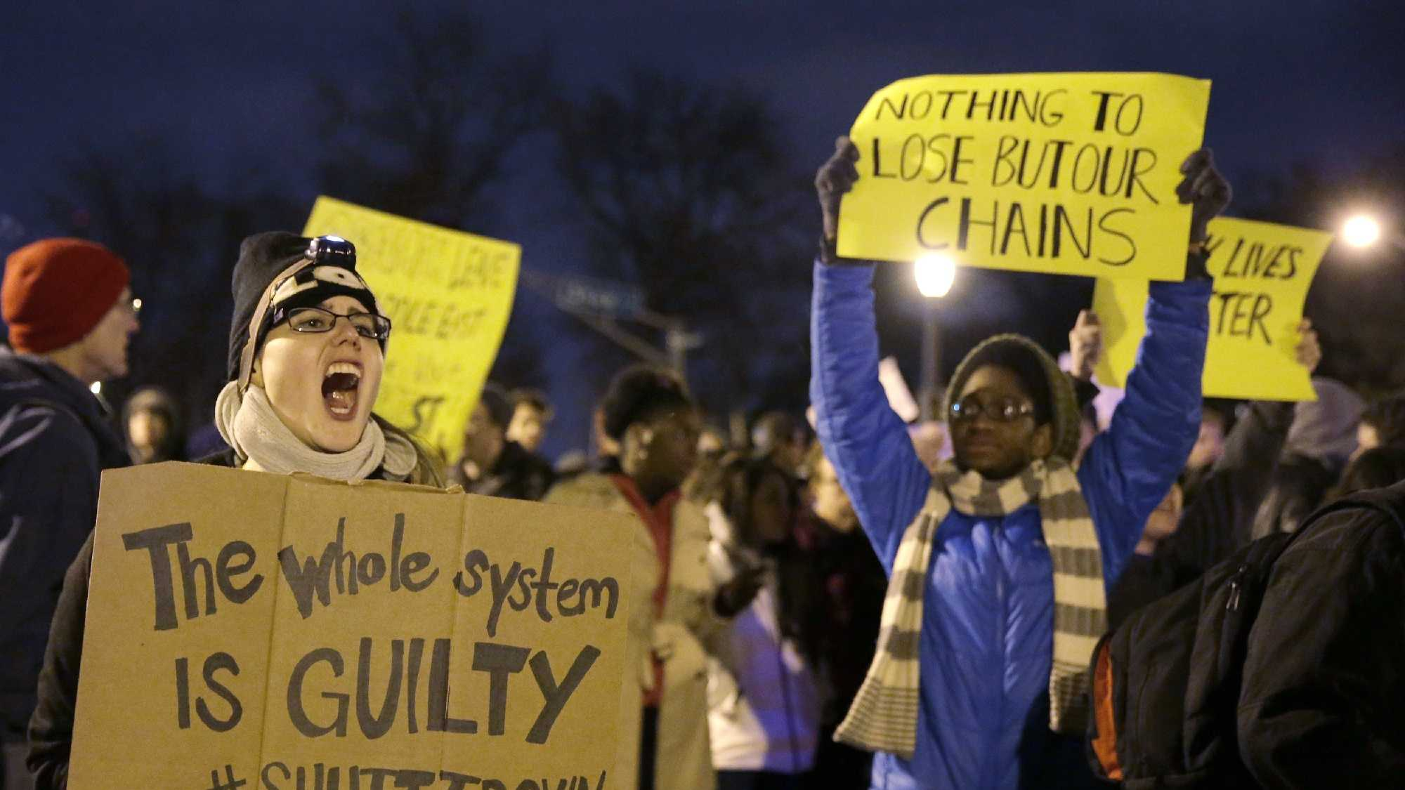 Protesters block streets after the announcement of the grand jury decision, Monday, Nov. 24, 2014, in St. Louis, Mo. A grand jury has decided not to indict Ferguson police officer Darren Wilson in the shooting death of 18-year-old Michael Brown.