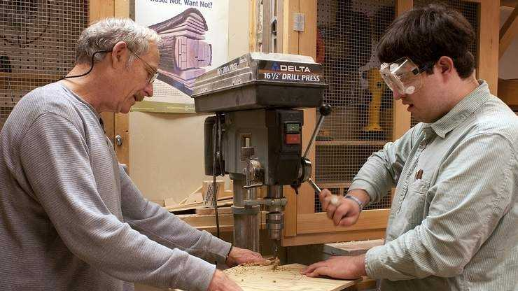 Wood shop teacher Steve Morral works with Stetson School student Nicholas Dudkiewicz in wood shop.
