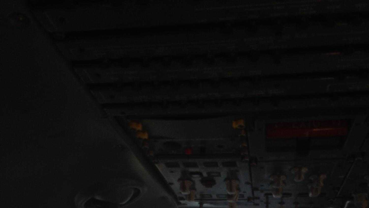 Damage to the windshield seen from inside the United plane.