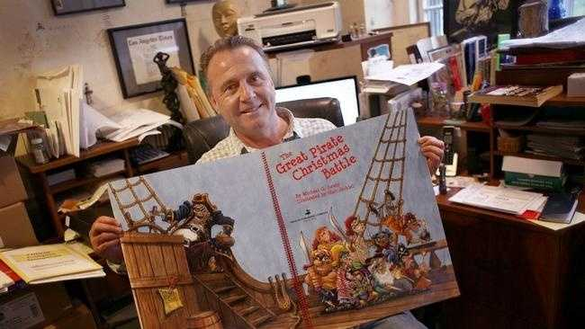 "Michael Lewis of Weymouth with his newly published children's book, ""The Great Pirate Christmas Battle"" Monday, Oct. 27, 2014."