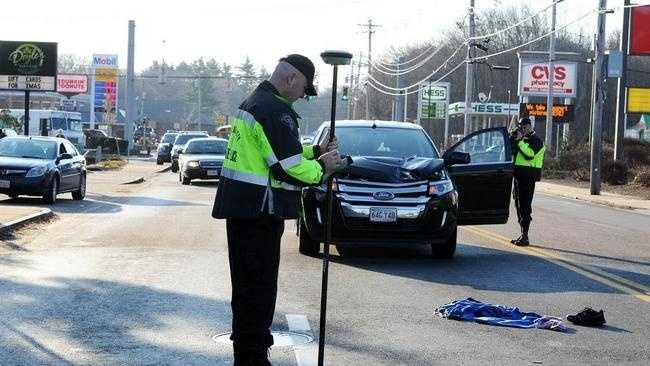 State police take measurements at the scene of a fatal pedestrian accident Monday on Pearl Street in Brockton.