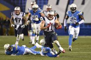 New England Patriots wide receiver Julian Edelman (11) pulls free from San Diego Chargers cornerback Brandon Flowers (26) and strong safety Marcus Gilchrist (38) as he runs for a touchdown against the San Diego Chargers during the second half in an NFL football game Sunday, Dec. 7, 2014, in San Diego.