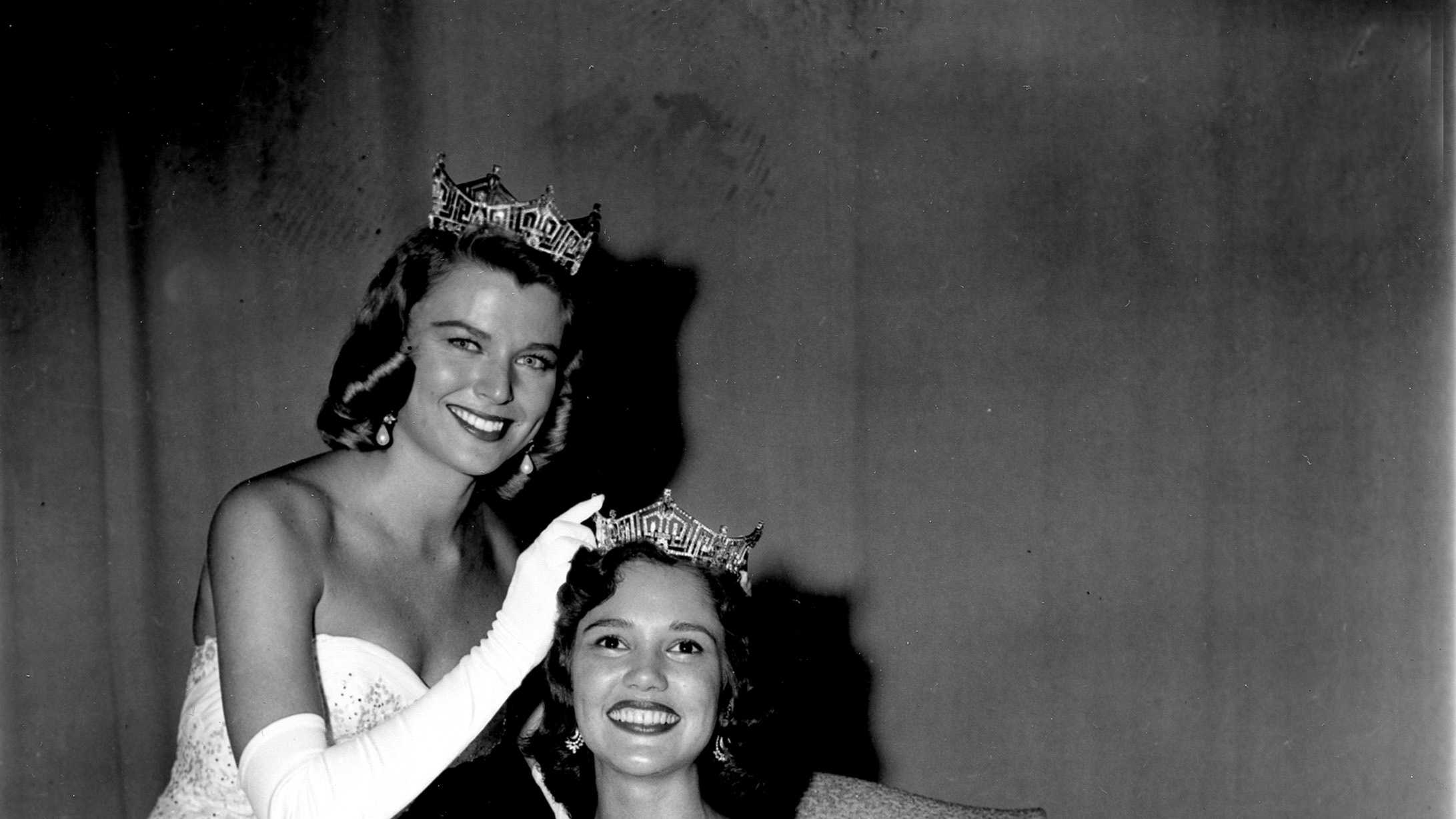 Miss America 1959, Mary Ann Mobley, of Brandon, Mississippi, is crowned by outgoing Miss America Marilyn Elaine Van Derbur at the annual Miss America Pageant in Atlantic City, N.J., on Sept. 6, 1958.