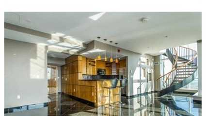 This spectacularly renovated corner penthouse duplex is a one-of-a-kind home offering approx.