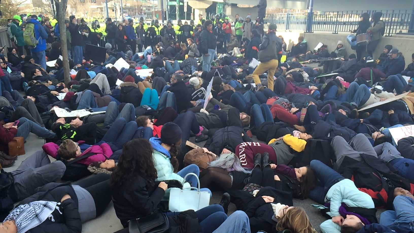 "Protesters stage a ""die-in"" near North Station in Boston on Saturday."