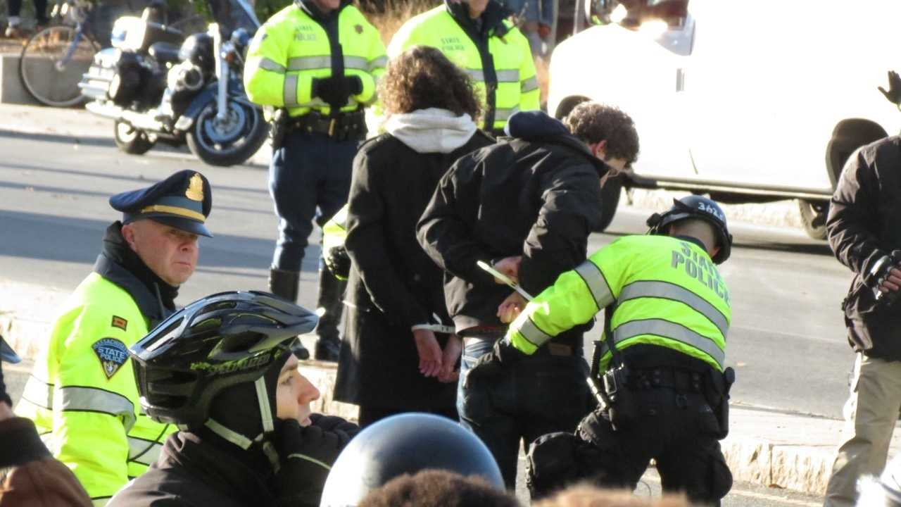 More than 20 people were arrested Saturday in Boston while protesting recent grand jury decisions not to indict  police officers involved in the deaths of unarmed black men.