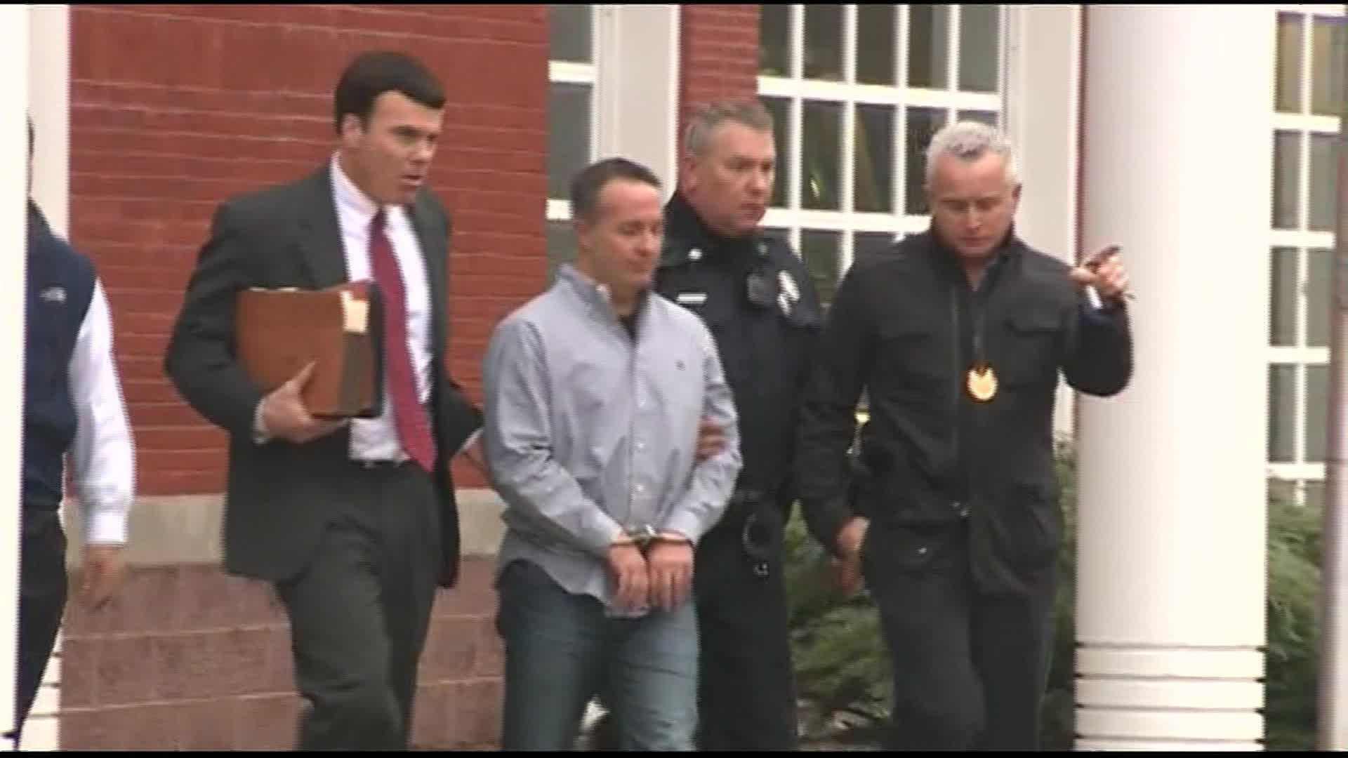 Co-founder and former NECC head pharmacist Barry Cadden is led out of Wrentham Police Department in handcuffs.