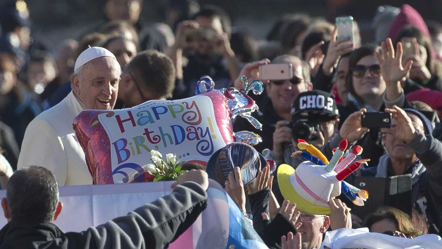 Pope Francis stands by a balloon reading Happy Birthday as he arrives for his weekly general audience in St. Peter's Square at the Vatican, Wednesday, Dec. 17, 2014. Pope Francis celebrates his 78th birthday Wednesday.