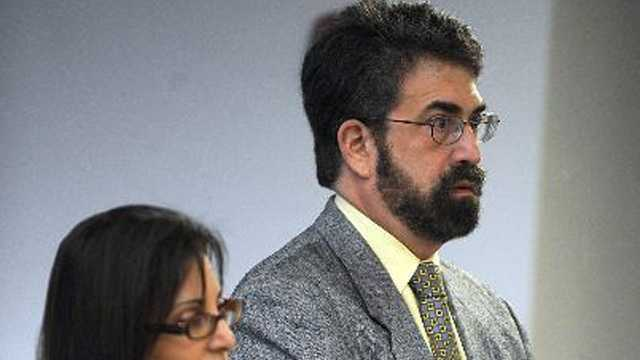 Pediatric dentist Melvin Ehrlich, a Millis resident who practiced in Framingham, is shown at his arraignment in Middlesex Superior Court in 2012. At left is his attorney Juliane Balliro.