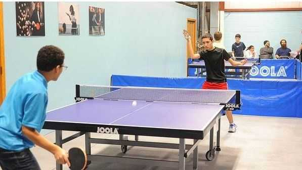 Young competitors take part in a table tennis competition at Smash Table Tennis Club in Fall River.