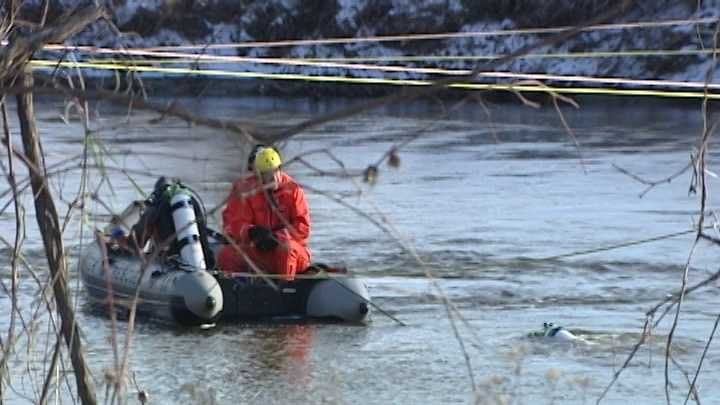 Crews attempt to recover a submerged car and passenger