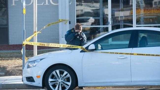 Authorities investigated a car outside the Waltham Police station on Lexington Street, Wednesday, Dec. 31.